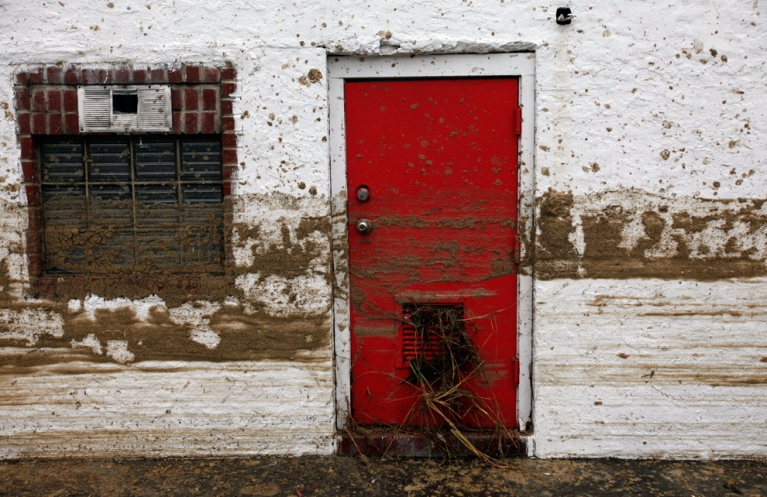 Sand marks the floodwater line on the side of a house in the aftermath of superstorm Sandy on Oct. 30 in Long Beach, N.Y.